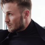 Male Model in black Turtleneck and black Coat