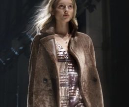 Woman on runway in coat